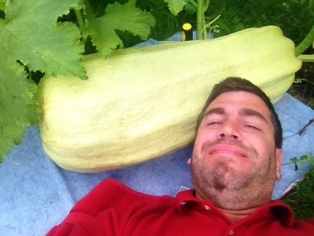A satisfied customer with a large zuccini